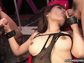Asian bitch in body fishnet Yui Shimizu is fucked by two kinky perverts