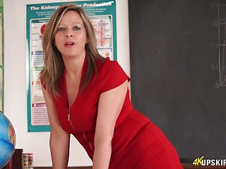 Slutty teacher in unexpected red attire Lou Pierce teases with regard to yummy twat upskirt